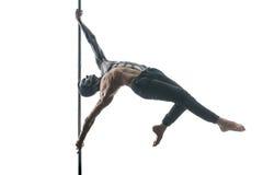 Männlicher Pfostentänzer mit Körperkunst auf Mast Stockbild