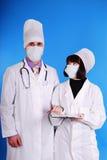 Männlicher und weiblicher Doktor. Lizenzfreies Stockbild