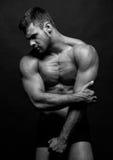 Männlicher vorbildlicher Konstantin Kamynin mit Muskeln Stockbilder