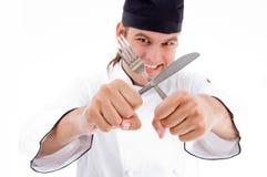 Männliches Chefholdingmesser und -gabel Lizenzfreies Stockfoto