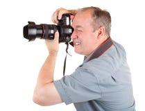 Männliches Fotograf-Schießen etwas Lizenzfreie Stockfotografie