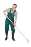 Männliches gardner mit Gartenarbeitwerkzeug? Lizenzfreies Stockfoto