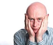 Männliches Interesse übergibt Gesicht auf weißem rückseitigem Tropfen Lizenzfreies Stockbild