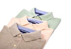 Mäns Polo Shirts Isolated på vit royaltyfria bilder