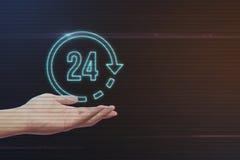 Mänsklig hand som rymmer 24 timmar symbol Royaltyfri Bild