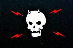 Mänsklig skalle med hornet Arkivfoto