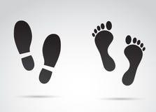 Mänskliga fotspår som isoleras på vit bakgrund Arkivbild