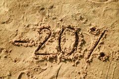 märka som 20 är skriftligt på sand Royaltyfria Bilder