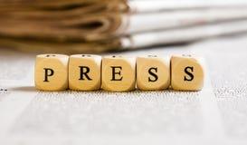 Märka tärnar begrepp: Press Arkivfoto