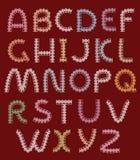 Märker av snör åt, alfabetet Fotografering för Bildbyråer
