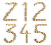 Märker och numrerar gjort av jordnötter Royaltyfria Foton