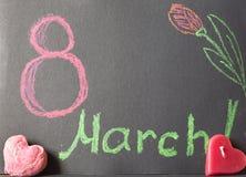 8. März auf schwarzem Hintergrund Lizenzfreie Stockfotos