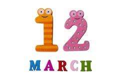 12. März auf weißem Hintergrund, Zahlen und Buchstaben Stockfoto