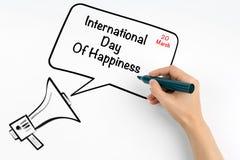 20. März internationaler Tag des Glückes Megaphon und Text auf einem weißen Hintergrund Stockbilder