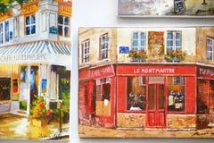 1. MÄRZ 2015 - PARIS: Malereien am Souvenirladen Lizenzfreie Stockfotos