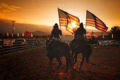 Mässafärger på hästrygg royaltyfria bilder