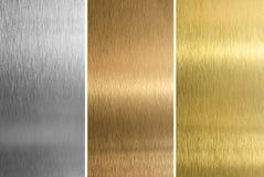 mässingsbronze guld- silvertexturer Royaltyfria Bilder