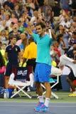 Mästare Roger Federer för storslagen Slam under den tredje runda matchen på US Open 2014 mot Marcel Granollers Arkivfoton