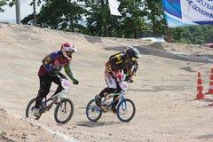 MÄSTERSKAP 2014 för BMX THAILAND - Juni 15, oidentifierade cyklister royaltyfri fotografi