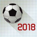 Mästerskap 2018 för fotbollvärldsfotboll på en rutig pappers- bakgrund Royaltyfria Foton