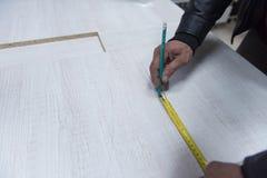 Mäta för snickarearbetare Royaltyfri Foto