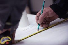 Mäta för snickarearbetare Arkivfoton