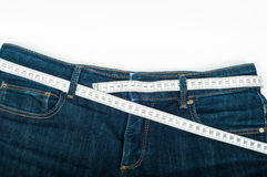 Mäta jeans Royaltyfria Bilder