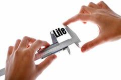 Mäta liv Arkivfoton