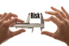 Mäta risk Arkivbild