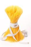 mätande spagettiband royaltyfria bilder