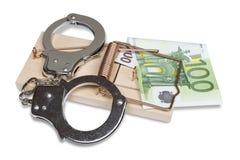Mäusefalle, Handschellen und Eurogeld Stockbilder