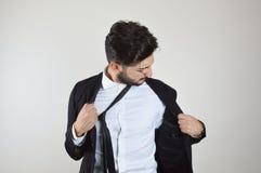 Młodego biznesmena emocjonalny stres i zanudzający obraz royalty free