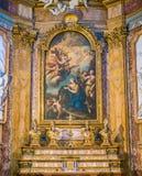 Måla 'botfärdiget Magdalen Adoring korsen av Michele Rocca, i altaret av kyrkan av Santa Maria Maddalena i Rome arkivbilder