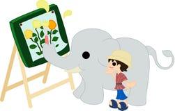 Måla vid en elefant. Arkivbild