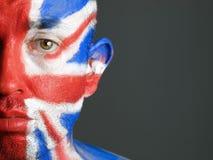 Målad flagga för man framsida av United Kingdom 5 Arkivfoto