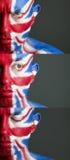 Målad flagga United Kingdom för man framsida Fotografering för Bildbyråer