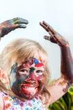 Målad flicka med handen i luft Fotografering för Bildbyråer