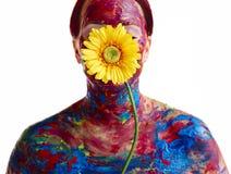 Målad kvinna och blomma Fotografering för Bildbyråer