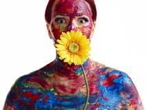 Målad kvinna och blomma Arkivbilder