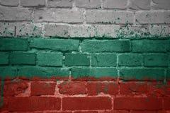 Målad nationsflagga av Bulgarien på en tegelstenvägg Fotografering för Bildbyråer
