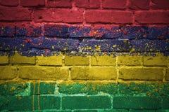 Målad nationsflagga av Mauritius på en tegelstenvägg Arkivbilder