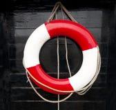 målad röd white för hand lifebelt arkivbilder