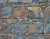 målad stenvägg arkivfoto
