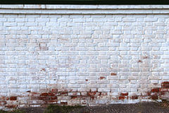 Målad tegelstenvägg Arkivbild