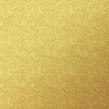 Målad texturbakgrund för guld- folie Fotografering för Bildbyråer
