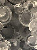 Målade cirklar i grå färger och svart arkivbilder