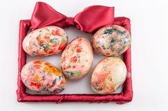 Målade easter ägg i en ram Royaltyfri Fotografi