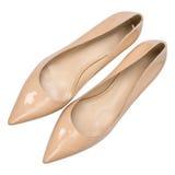 Målade glansiga skor för kvinnor beiga Royaltyfria Bilder