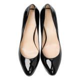 Målade glansiga skor för kvinnor svart Arkivfoto