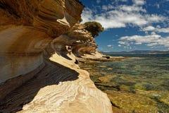 Målade klippor, Maria Island, Tasmanien, nationell reservation, Australien arkivfoton